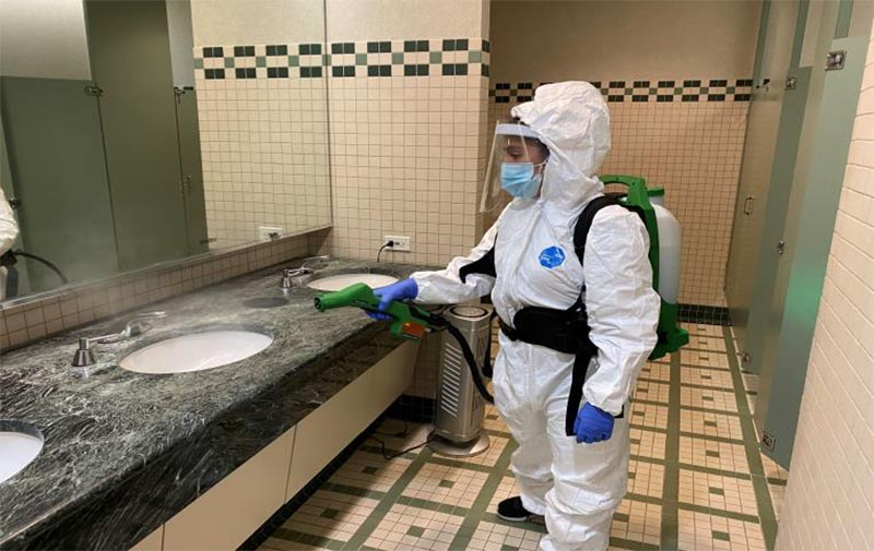 Our-Work-Disinfecting-bathroom-PCT-Disinfecting